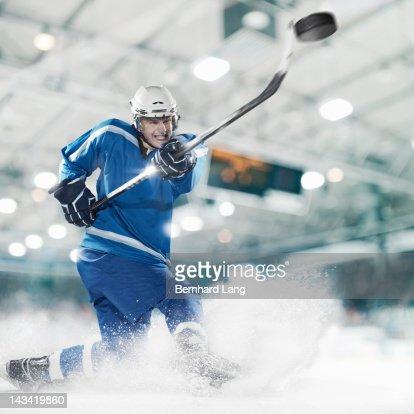 Ice hockey player shooting puck
