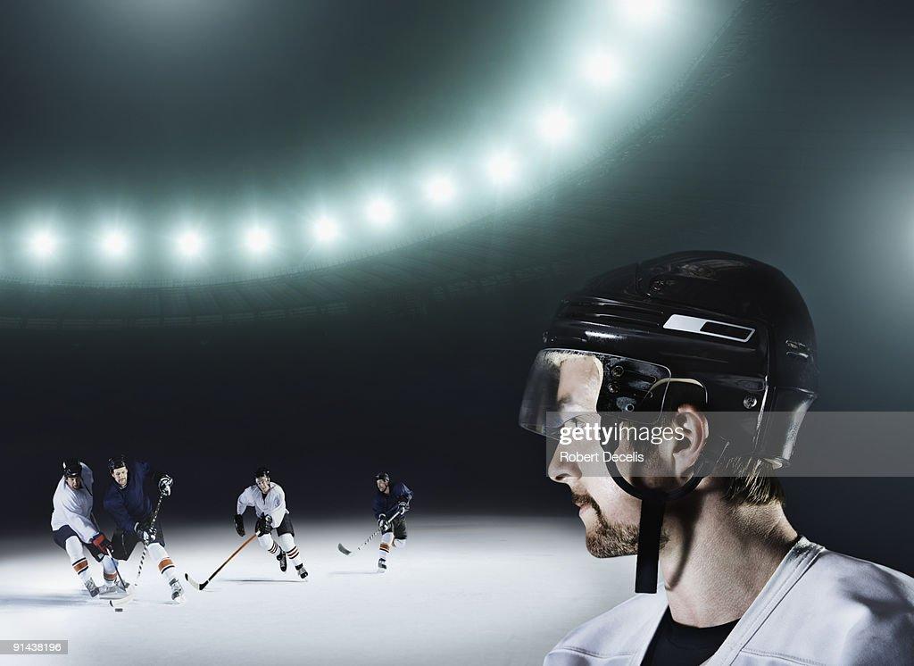 Ice Hockey player watching game. : Stock Photo
