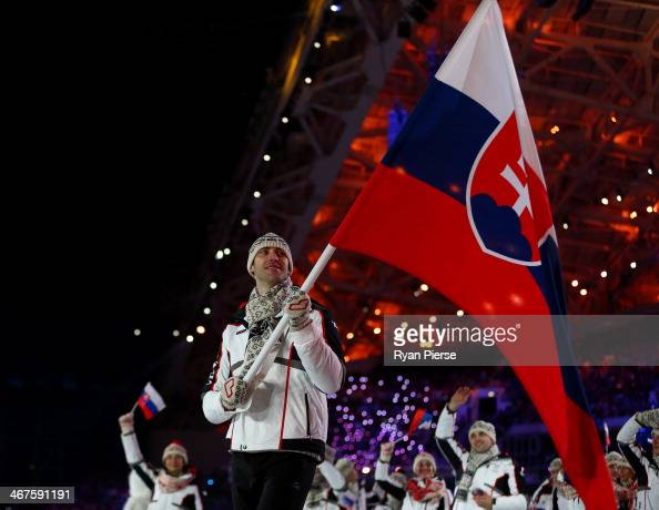 Ice hockey player Zdeno Chara of the Slovakia Olympic team carries his country's flag during the Opening Ceremony of the Sochi 2014 Winter Olympics...