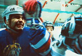Ice hockey, players clashing during game (blurred motion)