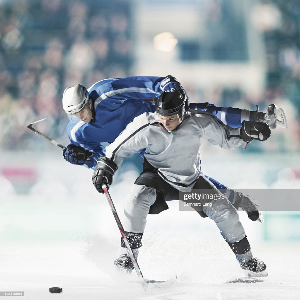Ice hockey players fighting for puck