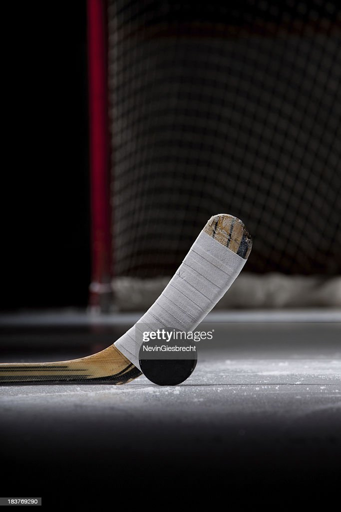 Ice Hockey Puck and Stick