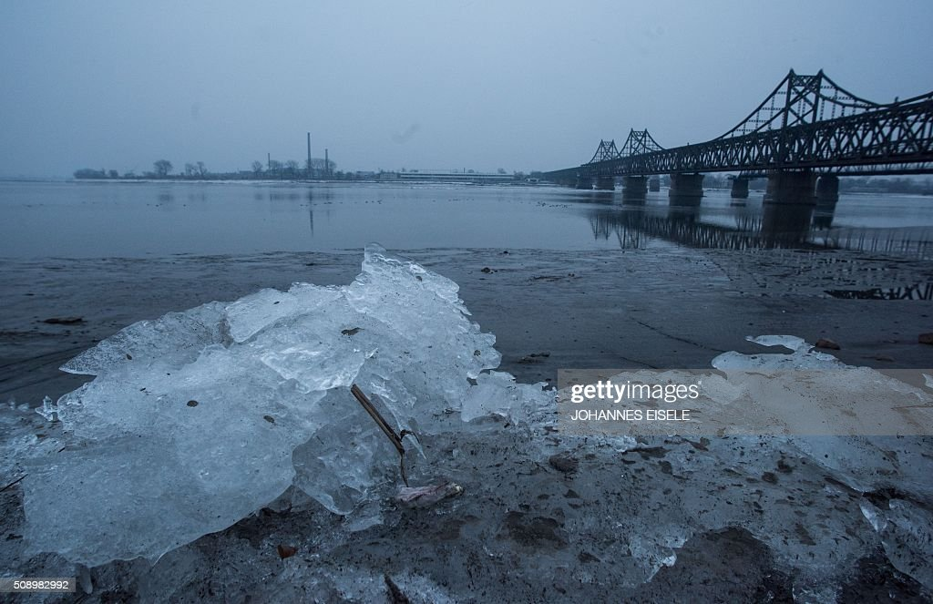 Ice is pictured on the banks of the Yalu River in the Chinese border town of Dandong, opposite to the North Korean town of Sinuiju, on February 8, 2016. The UN Security Council strongly condemned North Korea's rocket launch on February 7 and agreed to move quickly to impose new sanctions that will punish Pyongyang for 'these dangerous and serious violations.' With backing from China, Pyongyang's ally, the council again called for 'significant measures' during an emergency meeting held after North Korea said it had put a satellite into orbit with a rocket launch. AFP PHOTO / JOHANNES EISELE / AFP / JOHANNES EISELE