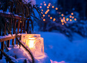 Traditional outdoor decoration in Finland in winter. The block of ice is usually made by leaving a bucket of water to stay outside overnight in cold temperature. The result is a hollow block of ice. B