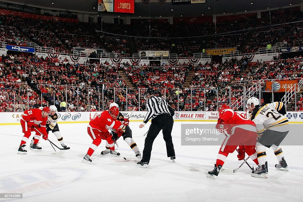 Ice level view of the faceoff between Justin Abdelkader #8 of the Detroit Red Wings and Vladimir Sobotka #60 of the Boston Bruins on November 3, 2009 at Joe Louis Arena in Detroit, Michigan.