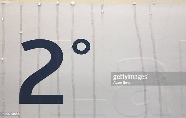 Ice melts down the figure 'Two Degrees' a figure used as a target to keep humanmade global warming below on the side of a carbonneutral train about...