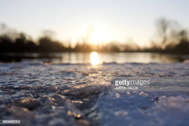 Ice on the jetty is pictured at Highgate Men's Bathing Pond in north London on December 12 at sunrise on a freezing winter morning / AFP PHOTO /...