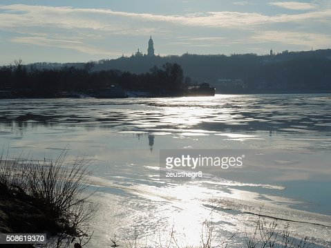 ice river with church reflection : Stock Photo