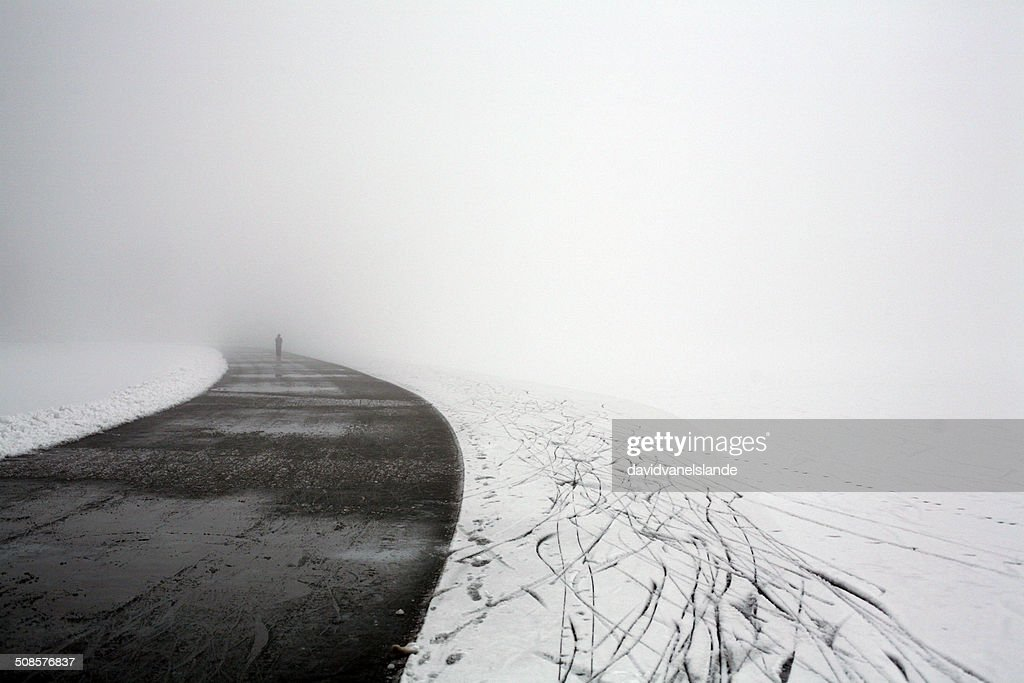 Ice road on a frozen lake : Stock Photo