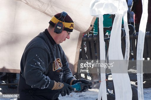 Ice Sculptor Drills Artwork at Winter Carnival : Stock Photo