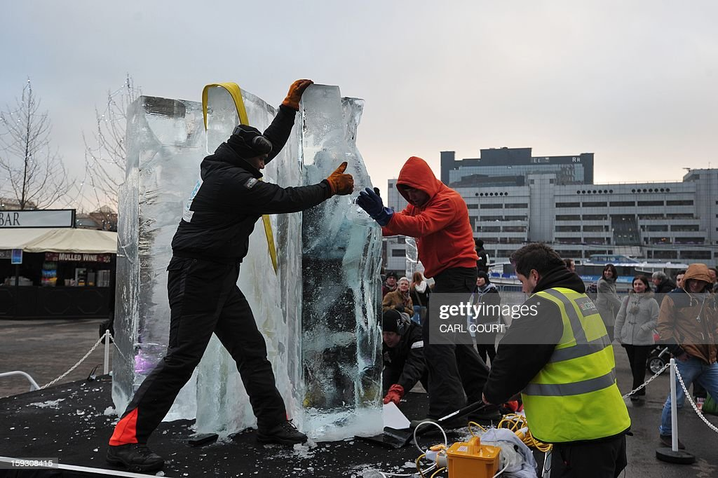 Ice sculptors works on a block of ice during the London Ice Sculpting Festival in Canary Wharf, east London, on January 11, 2012. Competitors from Britain, the US, France, Hungary, Bulgaria, Spain, Sweden, Netherlands, Latvia, Belgium and Portugal are competing in the festival which runs from January 11-13, 2013. AFP PHOTO / CARL COURT