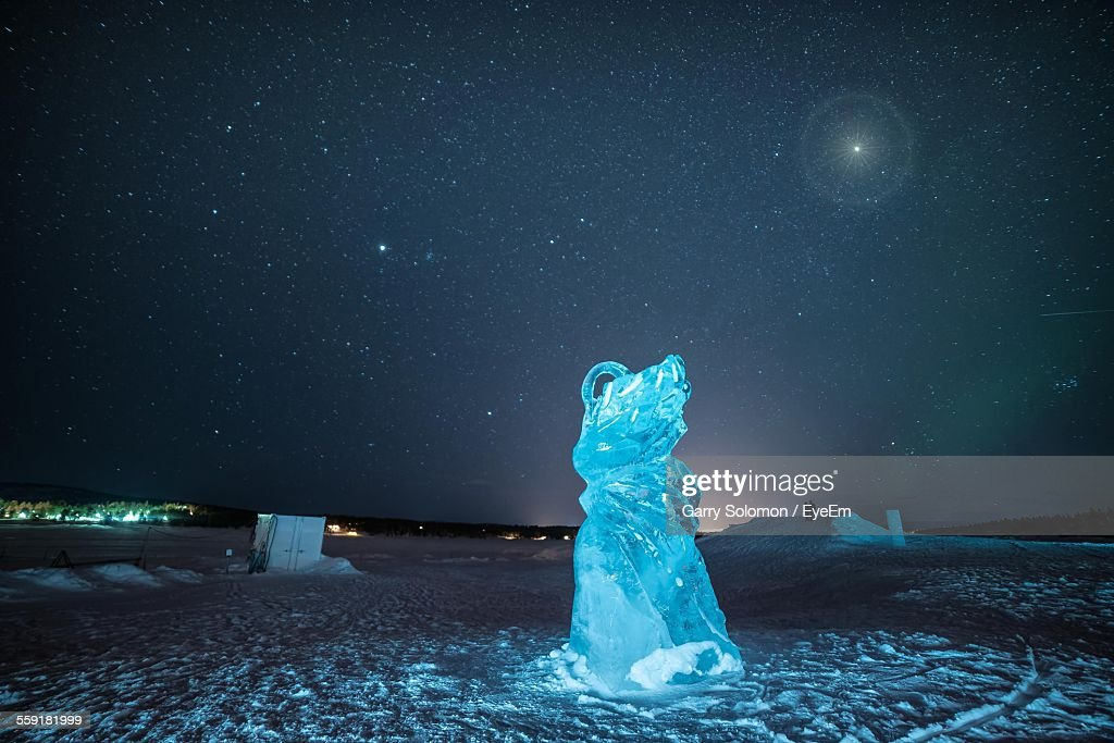 Ice Sculpture On Snow Covered Landscape At Night