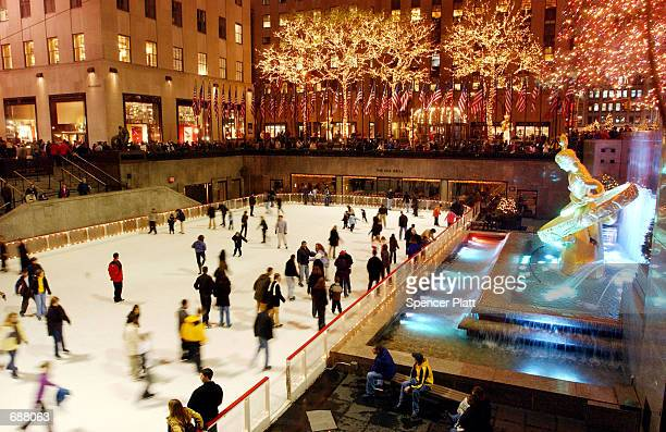 Ice skaters enjoy a festive evening at the ice rink at Rockefeller Center December 17 2001 in New York City While security is a little tighter this...