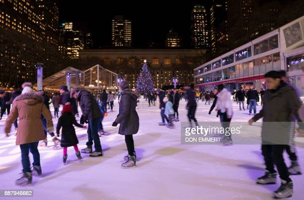 Ice skaters enjoy the outdoor ice rink at Bryant Park December 7 2017 in New York / AFP PHOTO / DON EMMERT