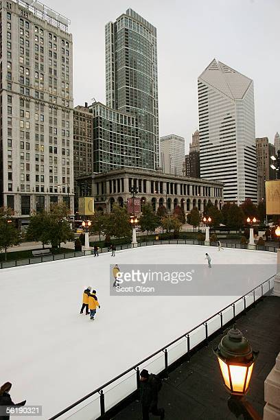 Ice skaters glide around the rink at Millennium Park November 16 2005 in Chicago Illinois Wind chills in the city hovered in the single digits on...