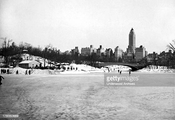 Ice skaters on a lake in Central Park New York New York c 1930