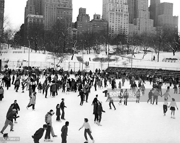 Ice skaters throng to the Park for skating fun at the 59th Street rink on a winter's day in Manhattan's Central Park New York New York circa 1952 The...