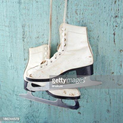 Ice skates on blue vintage wooden background : Stock Photo