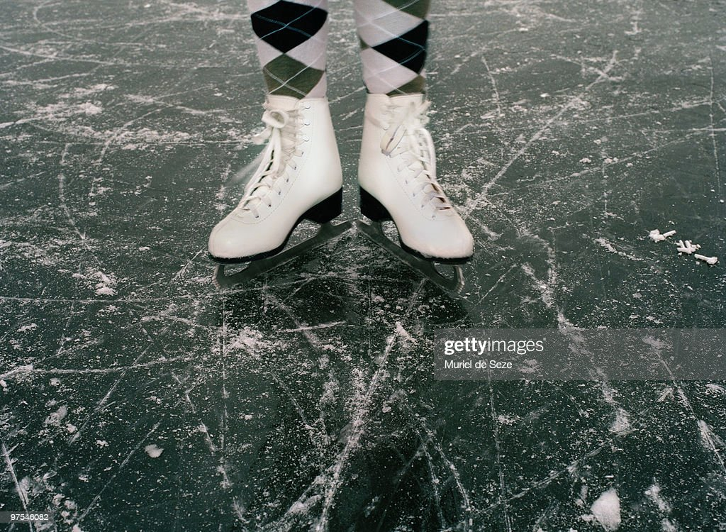 ice skates on ice : Stock Photo