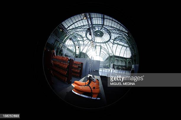 Ice skating boots are pictured in front of a giant rink hosted in the glassroofed central hall of the Grand Palais on December 12 2012 in Paris At...