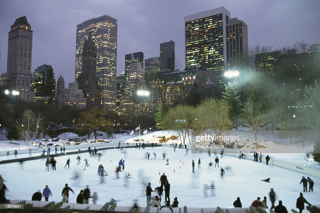 Ice skating in central park by night : Stock Photo