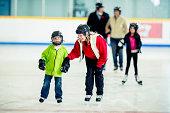 Ice skating at an indoor skating rink