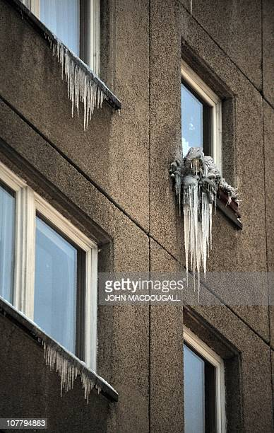 Ice stalactites hang from window sills in Berlin December 28 2010 Forecasts predict temperatures staying below zero AFP PHOTO / JOHN MACDOUGALL