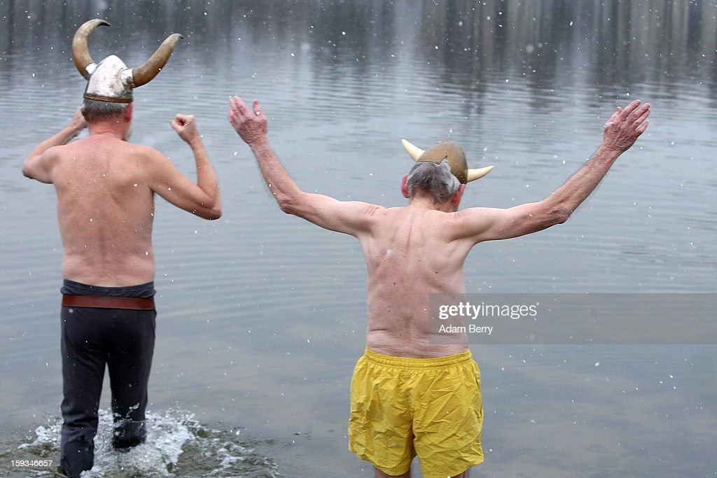 Ice swimming enthusiasts from Denmark dressed as vikings enter the cold waters of Orankesee lake during the 'Winter Swimming in Berlin' event on January 12, 2013 in Berlin, Germany. A local swimmers' group called the 'Berlin Seals' invite ice swimmers from across Germany and abroad to the annual event, which, despite warmer temperatures this winter and a lack of ice, was still held. Members claim ice swimming is good for the body's blood circulation.