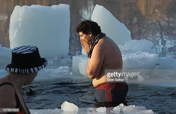 Ice swimming enthusiasts take to the frigid waters of Orankesee lake during the 27th annual 'Winter Swimming in Berlin' on January 8 2011 in Berlin...