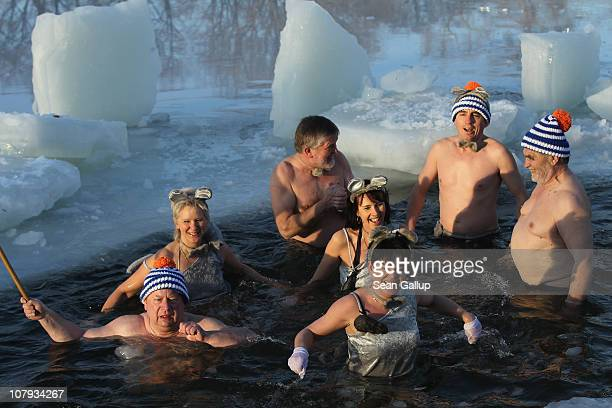 Ice swimming enthusiasts take to the frigid waters of Orankesee lake during the 27th annual 'Winter Swimming in Berlin' which this year had a kitchen...