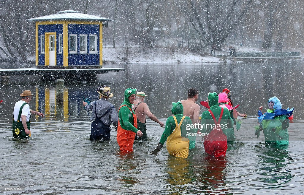 Ice swimming enthusiasts wade in the cold waters of Orankesee lake during the 'Winter Swimming in Berlin' event on January 12, 2013 in Berlin, Germany. A local swimmers' group called the 'Berlin Seals' invite ice swimmers from across Germany and abroad to the annual event, which, despite warmer temperatures this winter and a lack of ice, was still held. Members claim ice swimming is good for the body's blood circulation.