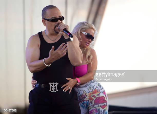 Ice T and Coco perform during the Motors and Music Experience in the parking lot of the Silverdome on August 18 2012 in Pontiac Michigan
