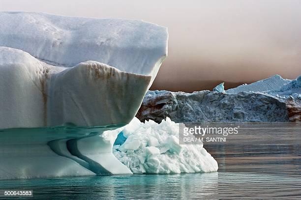 Iceberg detached from Jakobshavn glacier Ilulissat village Qaasuitsup west Greenland Denmark