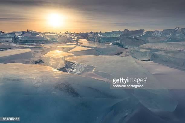 Iceberg formation on frozen lake