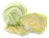 Iceberg lettuce sliced and whole over white