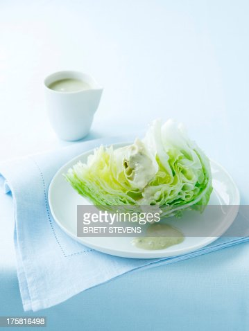 Iceberg lettuce with blue cheese dressing : Stock Photo