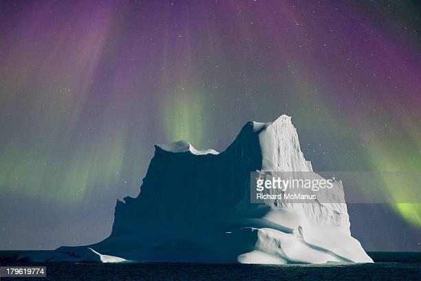 Iceberg shrouded by aurora
