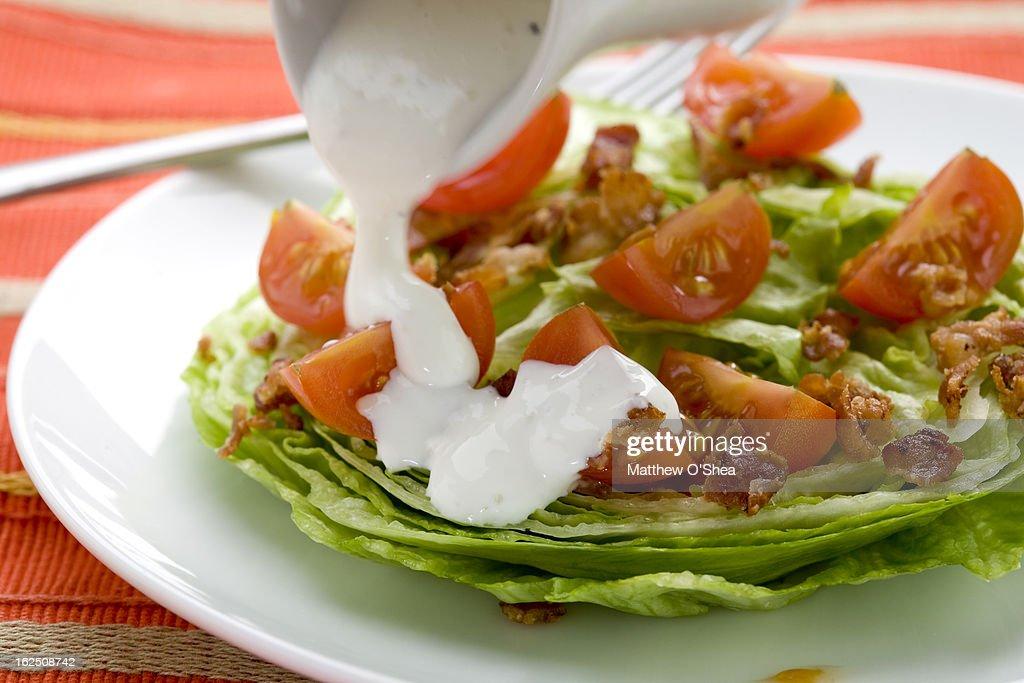 Iceberg 'wedge' Salad with bacon & tomatoes : Stock Photo