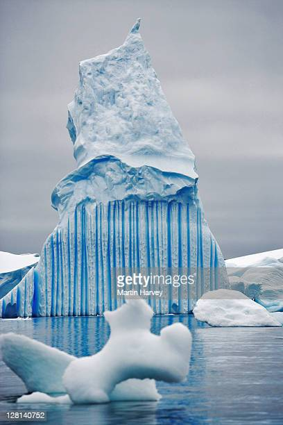 Icebergs are large pieces of ice that have broken off from a snow-formed glacier or ice shelf and are floating in open water. Around 90% of the volume is underwater. Antarctica.