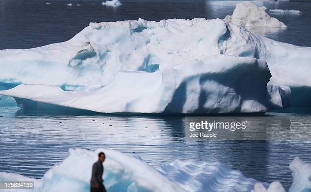 Icebergs are seen floating in the water on July 30 2013 in Narsaq Greenland As cities like Miami New York and other vulnerable spots around the world...