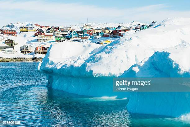 Icebergs, buildings on background