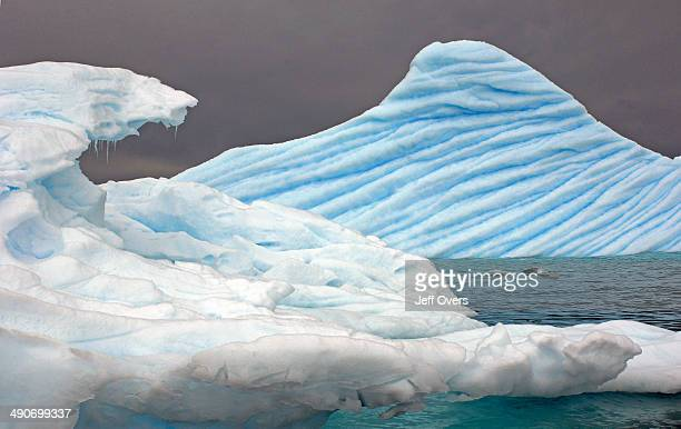Icebergs drift in the sea in Cierva Cove on the coast of the Antarctic Peninsula in Antarctica Southern Ocean polar iceberg blue