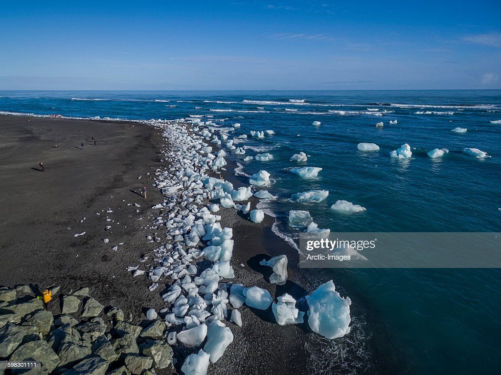 Icebergs from glacial ice on black sands.