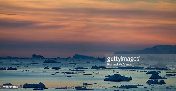 Icebergs in Disko Bay at sunset.