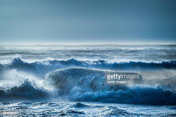 Icebergs in the sea with the waves crashing.