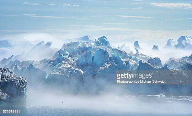 Icebergs shrouded in mist, Greenland