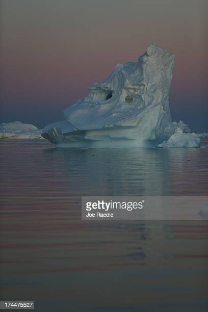 Icebergs that broke off from the Jakobshavn Glacier are seen floating in the water on July 23 2013 in Ilulissat Greenland As the sea levels around...