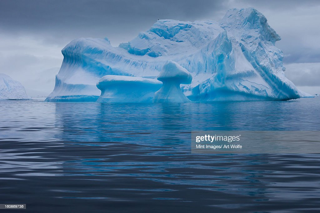 Icebergs with eroding and changing form drifting on the water, Antarctica : Stock Photo