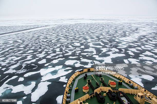 Icebreaker in the Arctic ocean cruising in pack ice