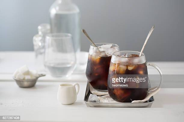 Iced black coffee in glass mug.